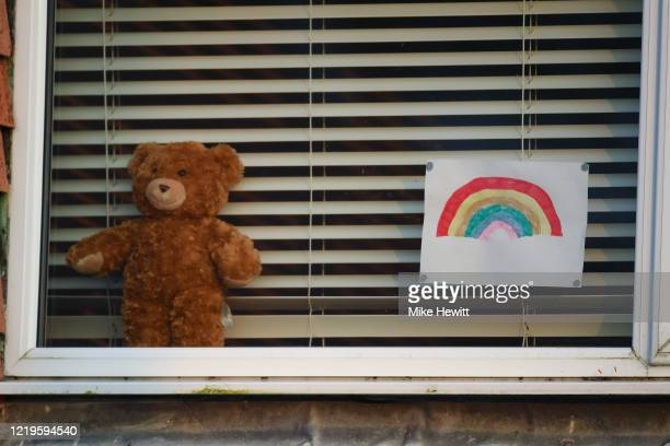 Rainbow picture and a teddy bear on display in a window on April 18, 2020 in Brighton, United Kingdom. In a press conference on Thursday, First...