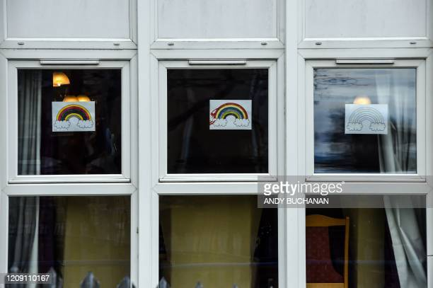 Rainbow pictures offering messages of hope to the public are seen in the windows of Burlington Court Care home in Cranhill in the East End of Glasgow...