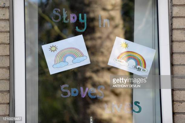 Rainbow posters, used as a symbol of hope during the coronavirus pandemic, are seen in the window at Oakland House care home in Manchester, northwest...