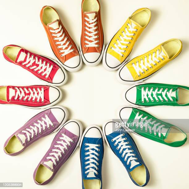 rainbow pride flag sneakers - purple shoe stock pictures, royalty-free photos & images