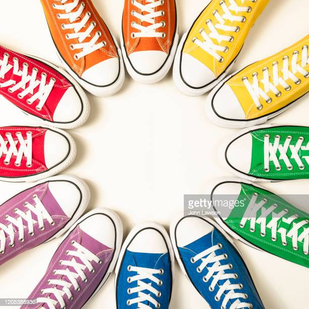 rainbow pride flag sneakers - royal blue stock pictures, royalty-free photos & images