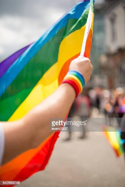 Rainbow pride flag waving during pride parade