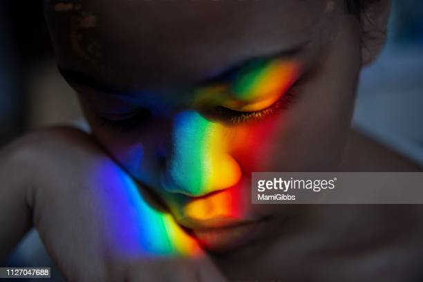 rainbow right reflected on the face - prism stock pictures, royalty-free photos & images