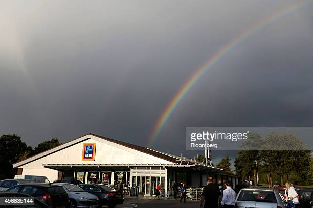 A rainbow rises beyond the roof of an Aldi discount supermarket operated by Aldi Stores Ltd at dusk in Chelmsford UK on Tuesday Oct 7 2014 Wm...