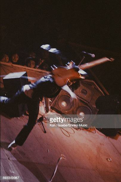 Rainbow Ritchie Blackmore throwing guitar on stage at Nippon Budokan Tokyo August 26 1981