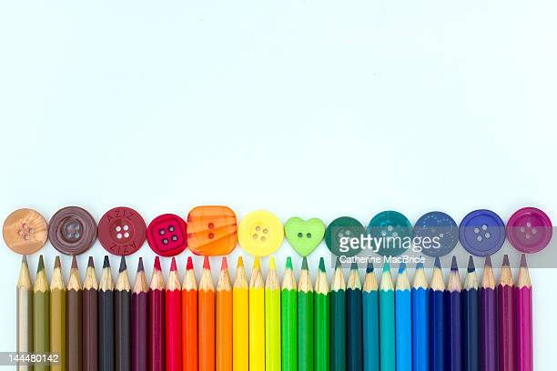 Rainbow rows of buttons and pencils