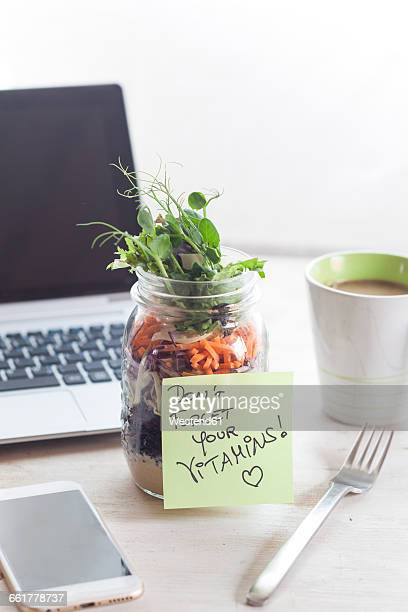 Rainbow salad in jar, notepade, dont forget your vitamins