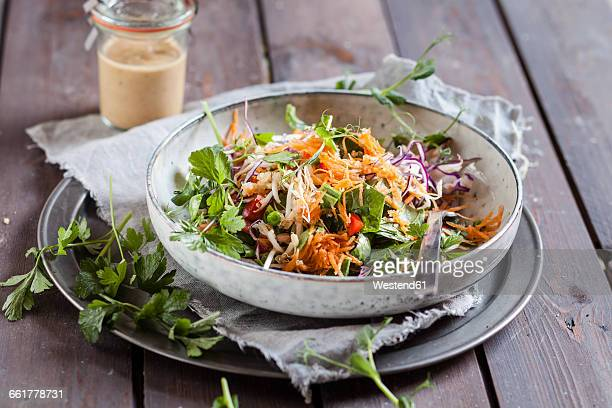 Rainbow salad with spinach leaves, peas, carrots, mung bean sprouts, quinoa, parsly, pea sprouts, red cabbage