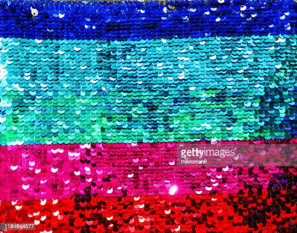 rainbow sequins texture background. - sequin stock pictures, royalty-free photos & images