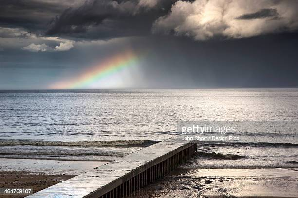 A Rainbow Shining In The Storm Clouds