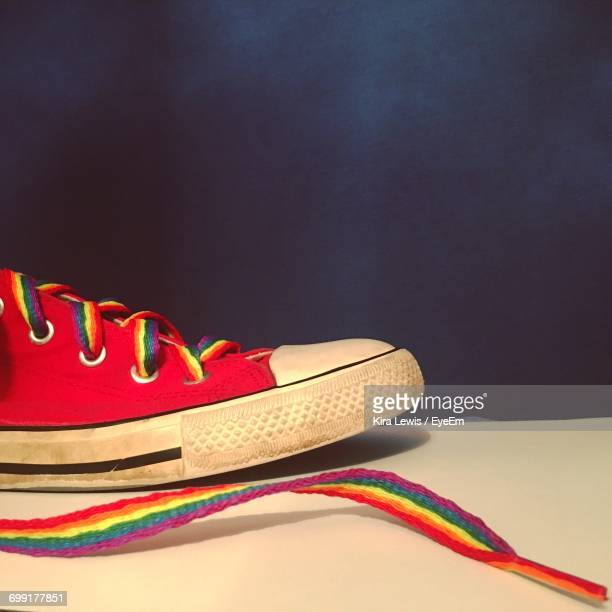 Rainbow Shoe On Table Over Blue Background