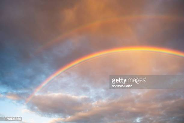 rainbow sky - sunlight stock pictures, royalty-free photos & images
