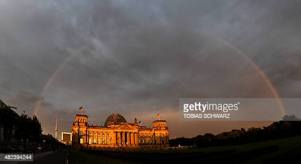 A rainbow spans over the Reichstag building seat of the German lower house of parliament in Berlin July 30 2015 AFP PHOTO / TOBIAS SCHWARZ / AFP /...