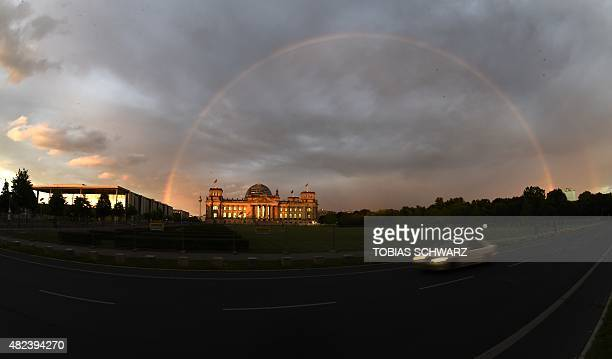 A rainbow spans over the Reichstag building seat of the German lower house of parliament in Berlin July 30 2015 AFP PHOTO / TOBIAS SCHWARZ