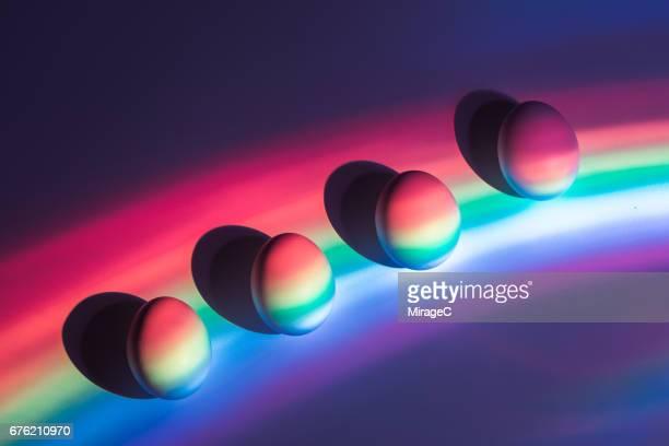 rainbow spectrum casting eggs - spectrum stock photos and pictures