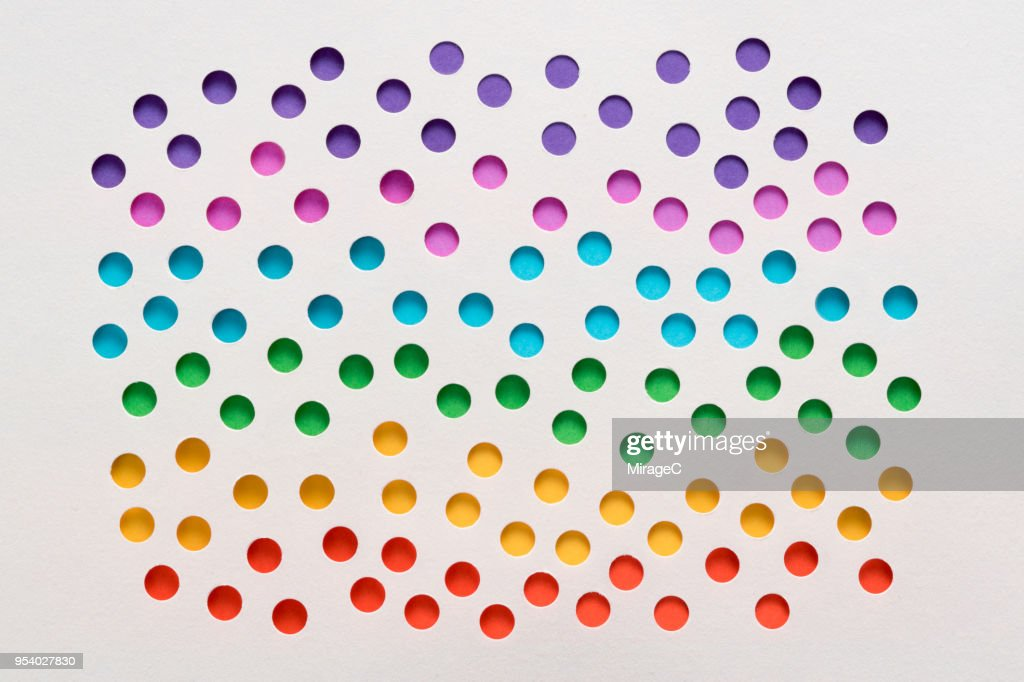 Rainbow Spots Perforated Paper Hole : Stock Photo