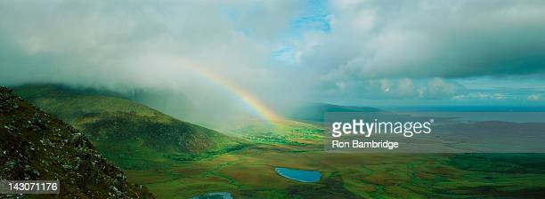 Rainbow stretching over rural landscape