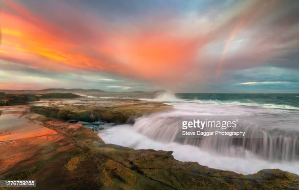 rainbow sunset - new south wales stock pictures, royalty-free photos & images