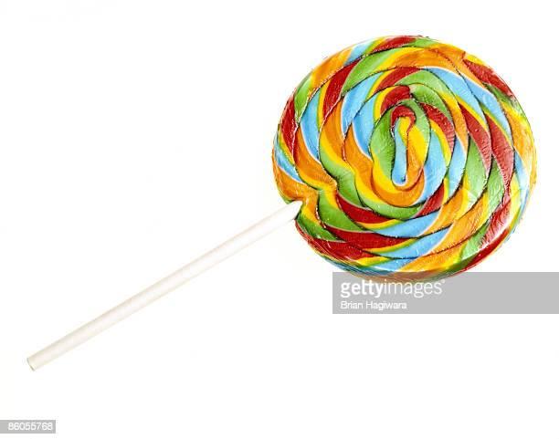Rainbow swirl lollipop on white