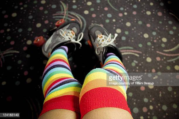 rainbow thigh high socks with roller skates - roller rink stock photos and pictures
