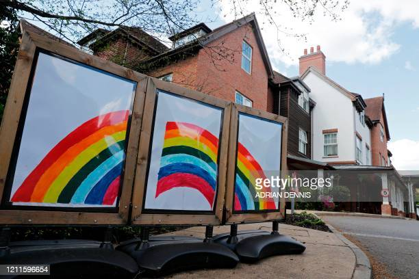 A rainbow triptych is seen outside the Sunrise Senior Living care home in Esher southwest of London on May 2 2020 as life in Britain goes on under...