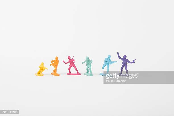rainbow troops - army soldier toy stock pictures, royalty-free photos & images