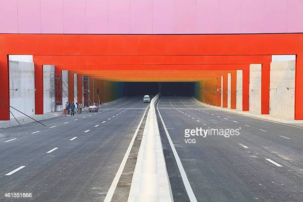A 'rainbow tunnel' is seen near ZhengzhouKaifeng urban express on January 13 2015 in Zhengzhou Henan province of China A 400meter tunnel under...