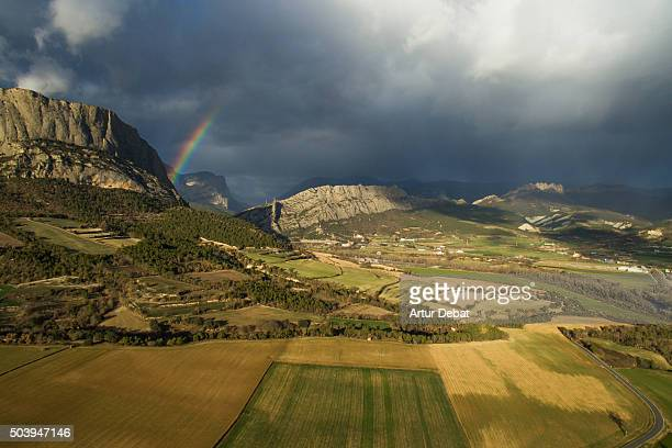 Rainbow with stormy sky in Pyrenees mountains in a aerial view.