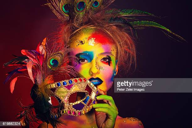 rainbow woman with a colorful venetian mask