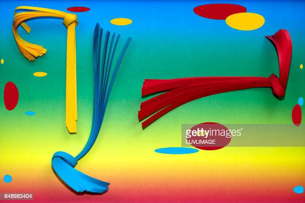 Rainbowcolored background with vibrant colored objects.