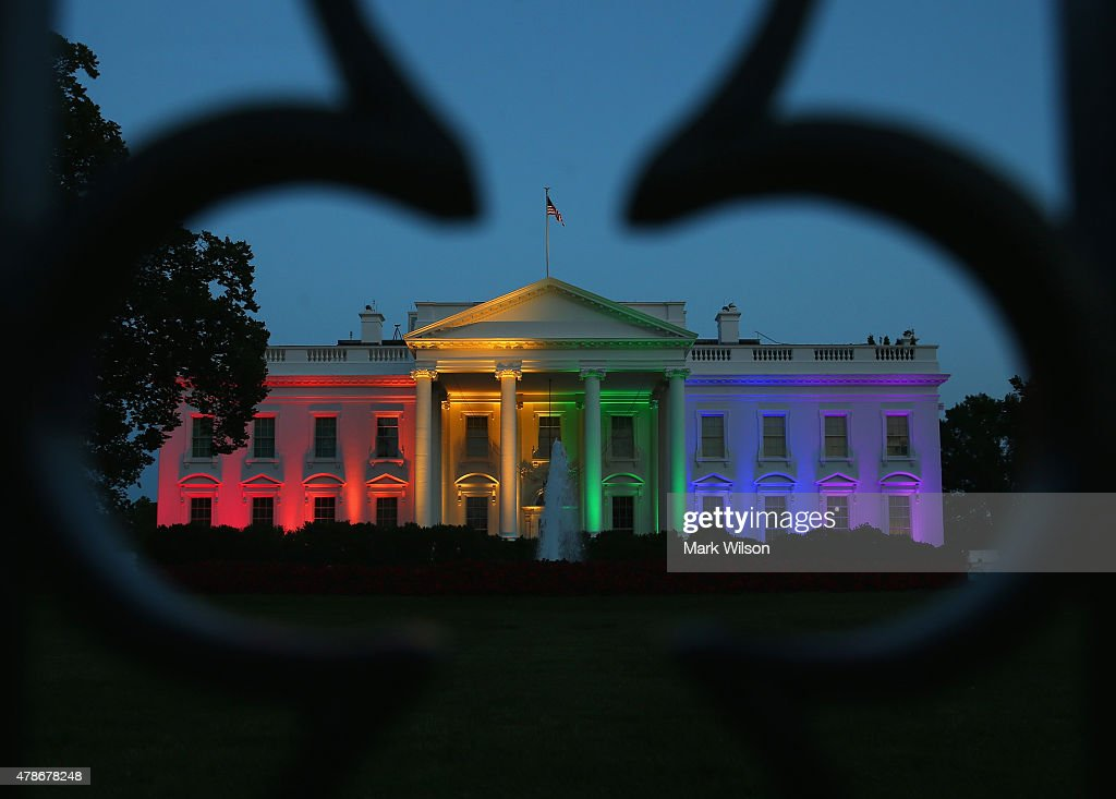 Rainbow-colored lights shine on the White House to celebrate today's US Supreme Court ruling in favor of same-sex marriage June 26, 2015 in Washington, DC. Today the high court ruled 5-4 that the Constitution guarantees a right to same-sex marriage in all 50 states.