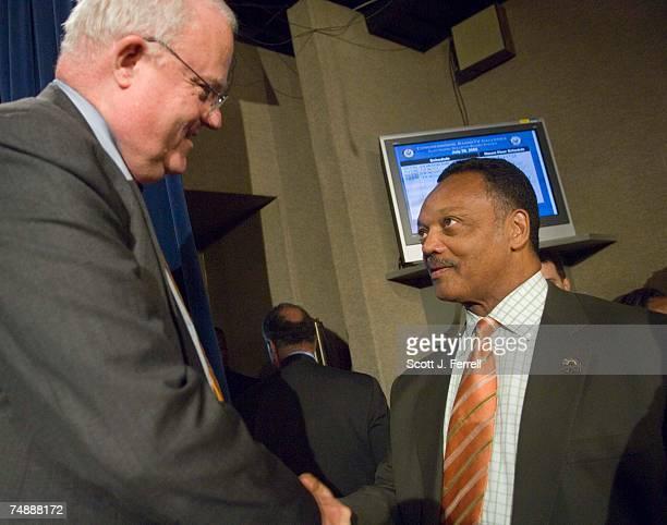 Rainbow/PUSH Coalition and civil rights leader Jesse Jackson congratulates House Judiciary Chairman F James Sensenbrenner Jr RWis left after a news...