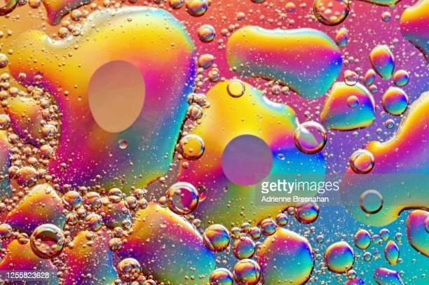 rainbows of mercury - mercury metal stock-fotos und bilder