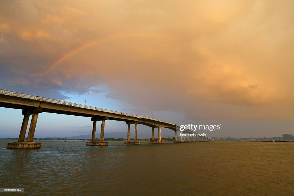 Rainbows over bridge cross : Stock Photo