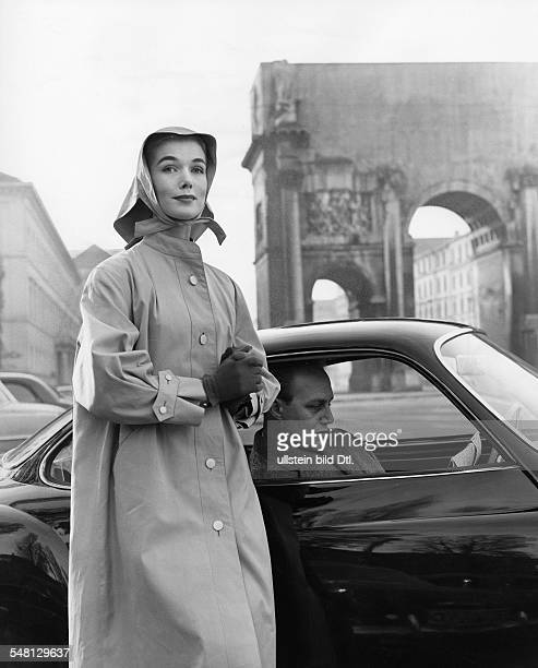 Raincoat with attached sleeve cuffs and poplin hood model 'Pirat' by Jobis Clothing Industry 1956 Photographer Regine Relang Published by 'Brigitte'...