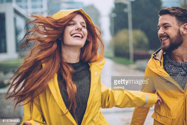 raindrops and happiness - raincoat stock photos and pictures