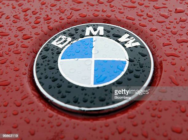 Raindrops are seen on the logo of a BMW Z4 automobile at the Bayerische Motorenwerke shareholders' meeting in Munich Germany on Tuesday May 18 2010...