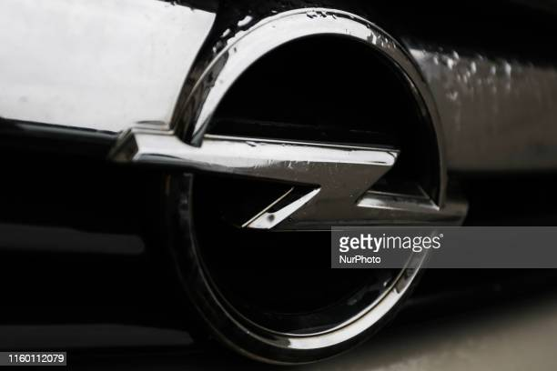 Raindrops are seen on the logo of Opel car in Krakow Poland on October 5 2016