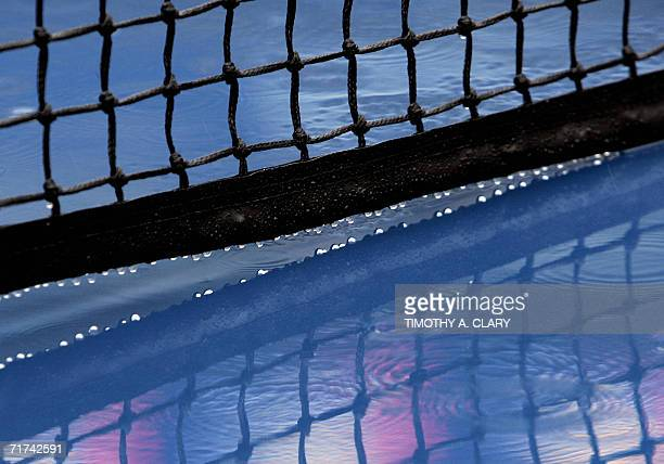 Raindrops come off the net on the court in Arthur Ashe Stadium as play was suspended at the 2006 US Open at the USTA National Tennis Center in New...