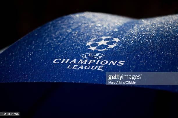 Raindrops form on an umbrella bearing the UEFA Champions league logo during the UEFA Champions League Semi Final First Leg match between Liverpool...