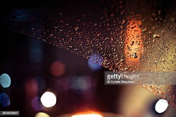 Raindrops on a car window during rain
