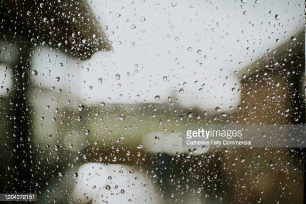 raindrops on a window - weather stock pictures, royalty-free photos & images