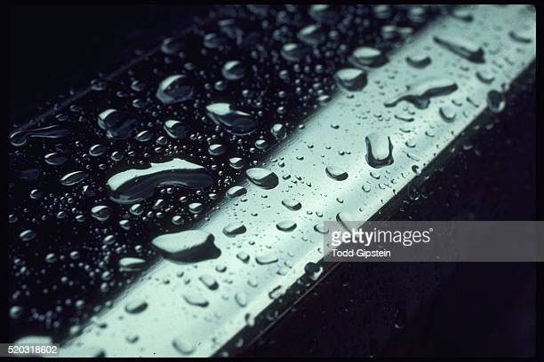 raindrops on chrome - gipstein stock pictures, royalty-free photos & images