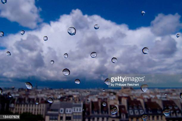 raindrops on glass with beaubourg - centre pompidou stock pictures, royalty-free photos & images