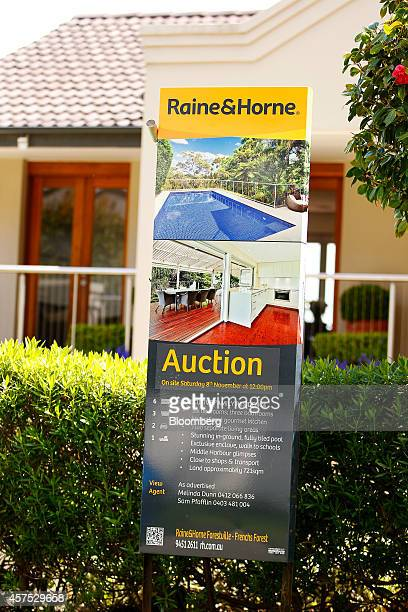 A Raine Horne auction sign stands on display outside a house in the suburb of Forestville in Sydney Australia on Saturday Oct 18 2014 Sydneys median...