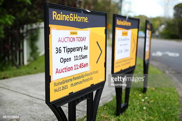 Raine Horne auction signs stand on display on a street in the suburb of Forestville in Sydney Australia on Saturday Oct 18 2014 Sydneys median home...