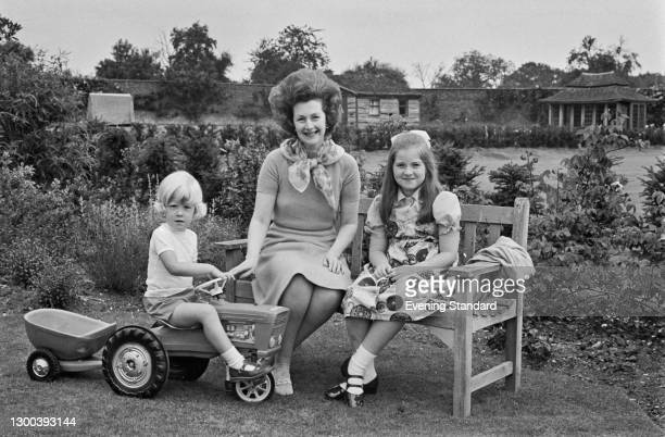 Raine, Lady Dartmouth , the wife of the 9th Earl of Dartmouth, with her youngest children Lady Charlotte Legge and the Honourable Henry Legge, UK,...