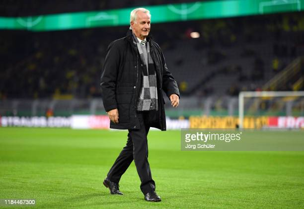Rainer Bonhof, Vice President Borussia Moenchengladbach walks on the pitch prior to the DFB Cup second round match between Borussia Dortmund and...