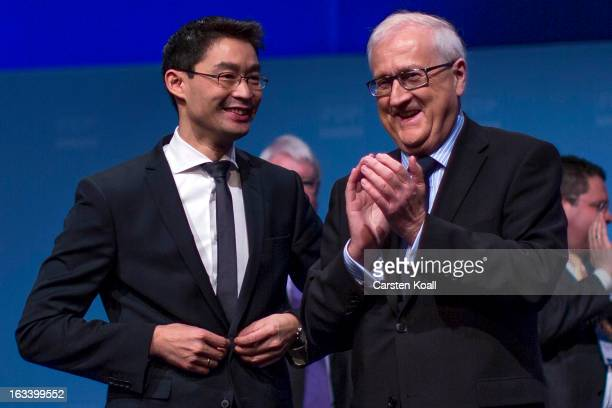Rainer Bruederle Bundestag faction leader of the German Free Democrats applauds Philipp Roesler German Economy Minister and Chairman of the German...
