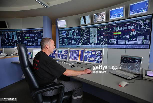 Rainer Heinz control room supervisor uses ABB Ltd software to monitor generator units at the EOn AG Staudinger coalpowered plant in Grosskrotzenburg...